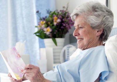 elderly women reading a card