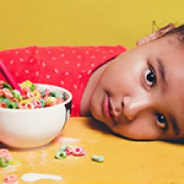 child with cereal